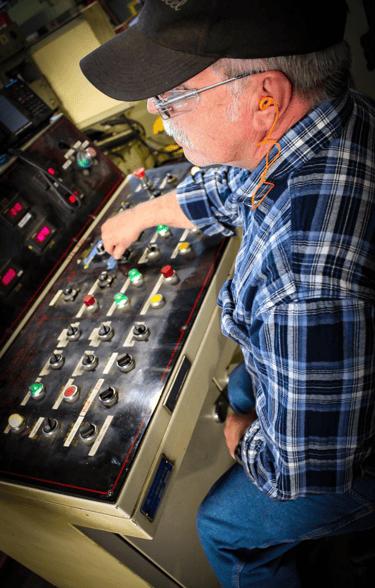 mechanical motion control hinge manufacturer- man at controls-1