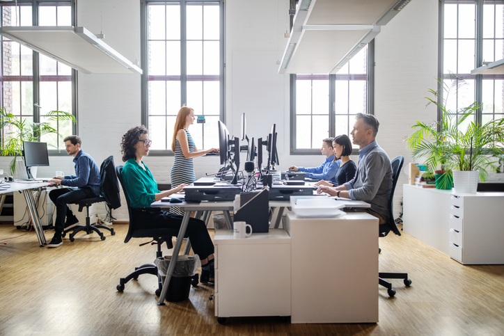 hot desking essentials - stand up desk in pod of workers
